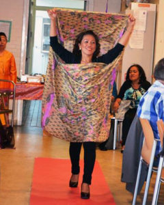 Margie Deleen is wearing the malong, a tubular skirt made of colorful handwoven or machine made cloth and a much loved popular garment originating from the south. Different tribes in the Philippines use this garment, which is similar to that of the sarong from Malaysia, Brunei and Indonesia.