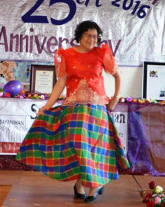 Bayanihan Chairperson Diana Oosterbeek-Latoza is wearing a traditional dress from Miagao Iloilio. Called the patadyong, this attire is worn on a daily basis for multifunctional use: as a wrap around skirt, as a shawl, and sometimes even as a blanket.