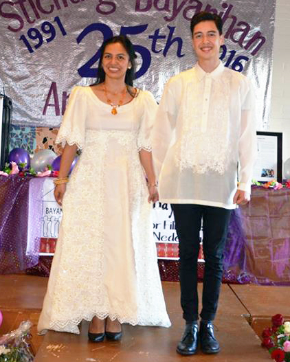 This centennial inspired Filipino wedding gown is worn by Myra Colis, who is escorted by Julian Claus in a traditional barong tagalog. Originally created for the wedding of Rochita Loenen-Ruiz, this wedding gown is made of jusi and decorated with lace and seed pearls.